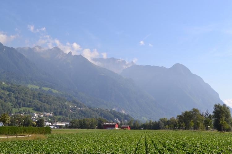 Liechtenstein views of the Swiss Mountains Beautiful scenery and green fields road trip through Europe