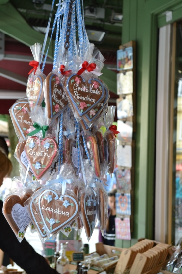 Market in munich in germany with edible hearts gingerbread icing hanging in a market stall
