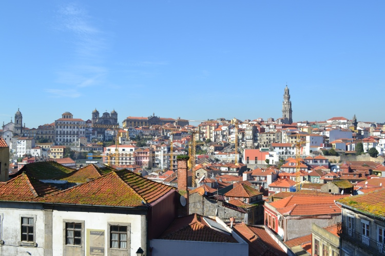 Views across Porto with the orange roofs and traditional tiles in Portugal panorama
