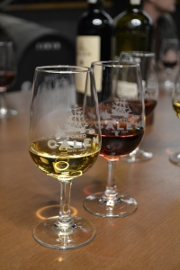 Port Glasses for tasting in the Calem Port Cellar in Porto Portugal a white port and a red port in small glasses