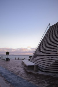 Loyly Sauna in Helsinki wooden architecture modern and traditional view out the sea in the winter walking out for an ice dip in the ocean serene and calming sauna
