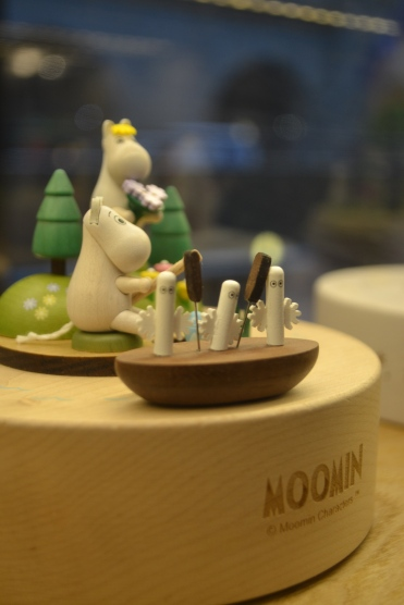 Moomin cafe in Helsinki city tiny wooden moomin characters in the window of the restaurant