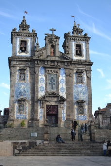A beautiful historic Blue Tiled Church in Porto Portugal on top of a hill with blue skies
