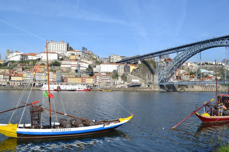 View of the river in Porto with boats and a view of the bridge
