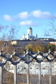 View of Helsinki Cathedral from a hill top with a close up of the gates in view