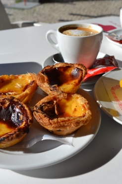 Natas - Portuguese Tarts a breakfast in Porto Portugal with a coffee outside in the sunshine