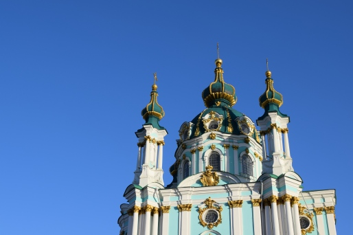 St Andrews Church a bright green and white church in Kyiv Ukraine with blue skies above it