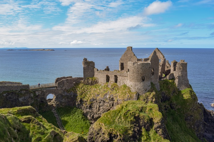 Castle ruins on a sunny day in Northern Ireland on the Causeway Coastal Route