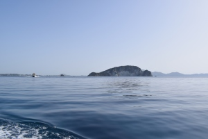 turtle island in the distance in front of an expanse of blue sea