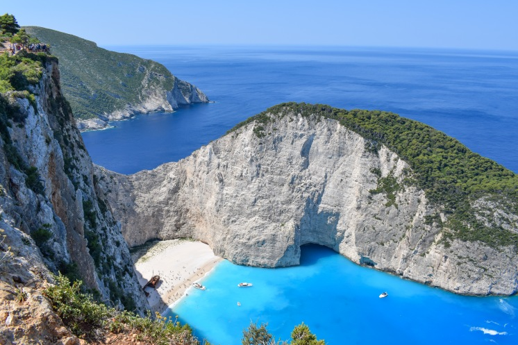 High up viewpoint on top of a cliff overlooking Navagio Beach Shipwreck beach in Zante Greece very blue sea and white sand