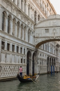 A view of The Bridge of Sighs Venice with a gondola in the canal below