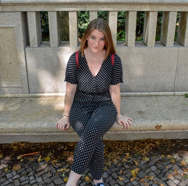 Girl on bench with spotty playsuit in Berlin